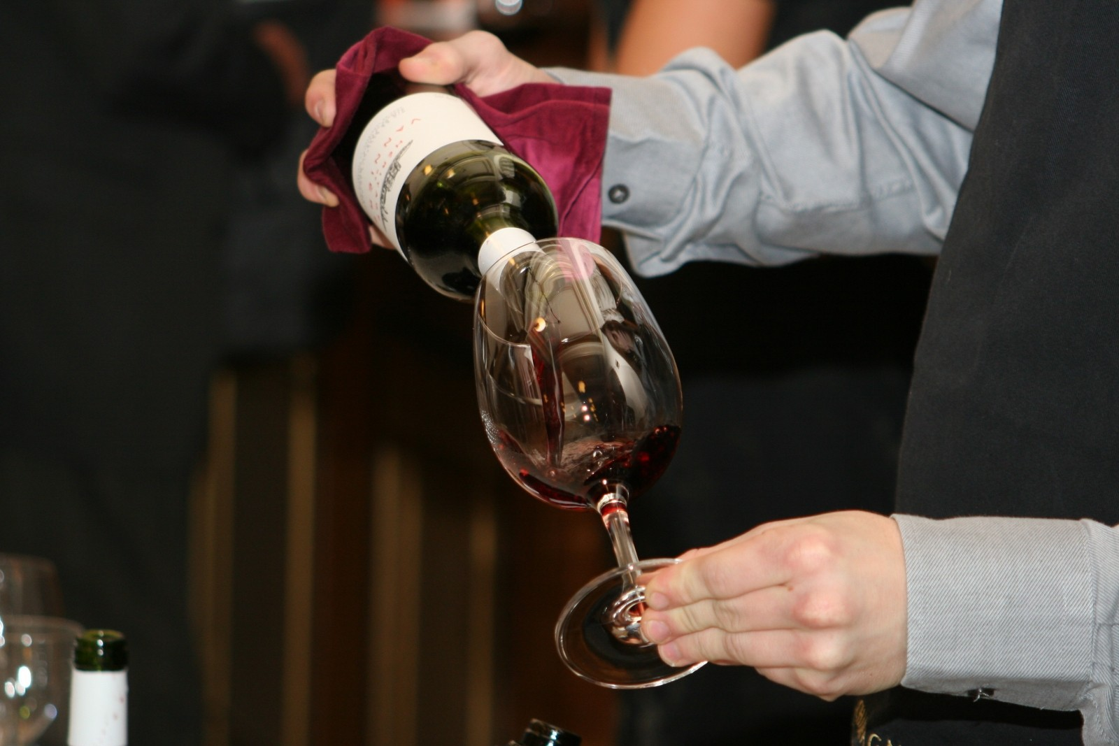 waiter-pouring-wine-from-bottle-into-wineglass.jpg