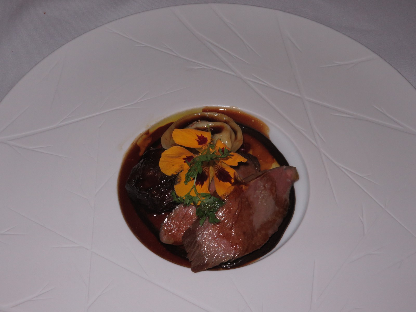 """Slow cooked shoulder & loin of lamb, piperade and goat's cheese ravioli"""