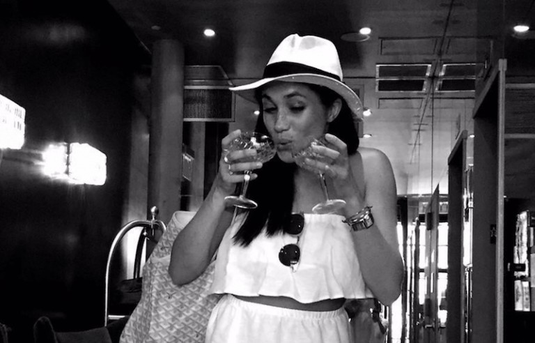 Meghan-Markle-drinking-two-glasses-of-wine-768x492.png