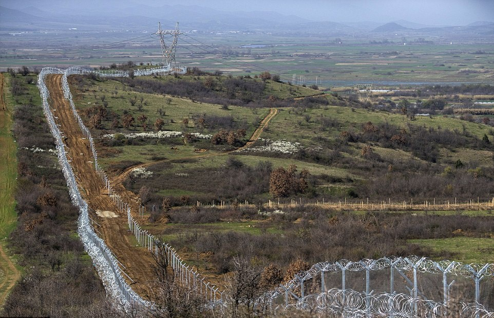 A colossal wall of razor wire and thick fencing now stretches along the Greek-Macedonian border near Idomeni, Greece.jpg