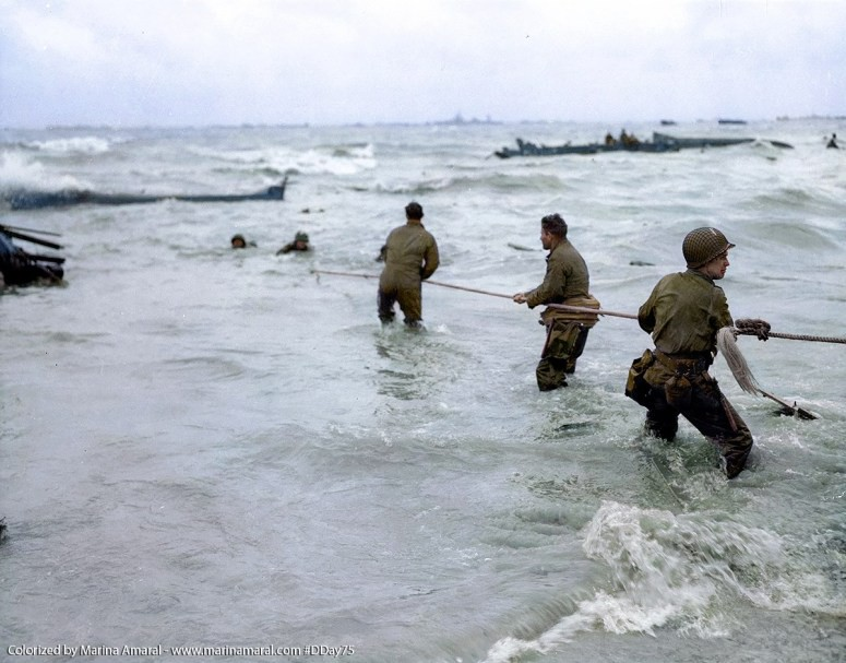 5 U.S.-troops-use-a-lifeline-to-rescue-several-men-from-a-landing-craft-that-was-sunk-by-enemy-fire-on-D-Day-6-June-1944-1.jpg