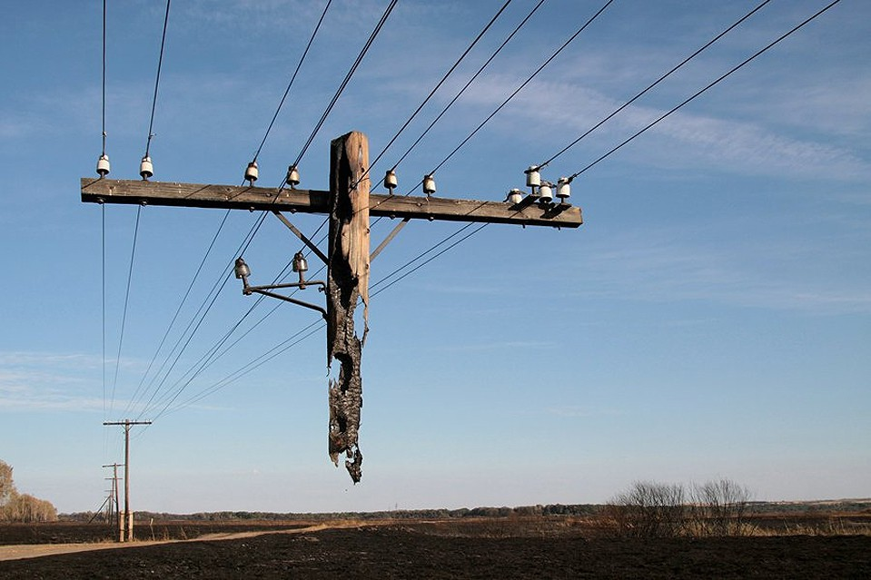 Electric pole hanging after a wild fire.jpg