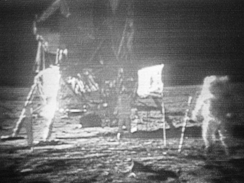 "In this July 20, 1969, image made from television, Apollo 11 astronaut Neil Armstrong, right, trudges across the surface of the moon. Edwin E. ""Buzz"" Aldrin is seen closer to the craft..jpg"
