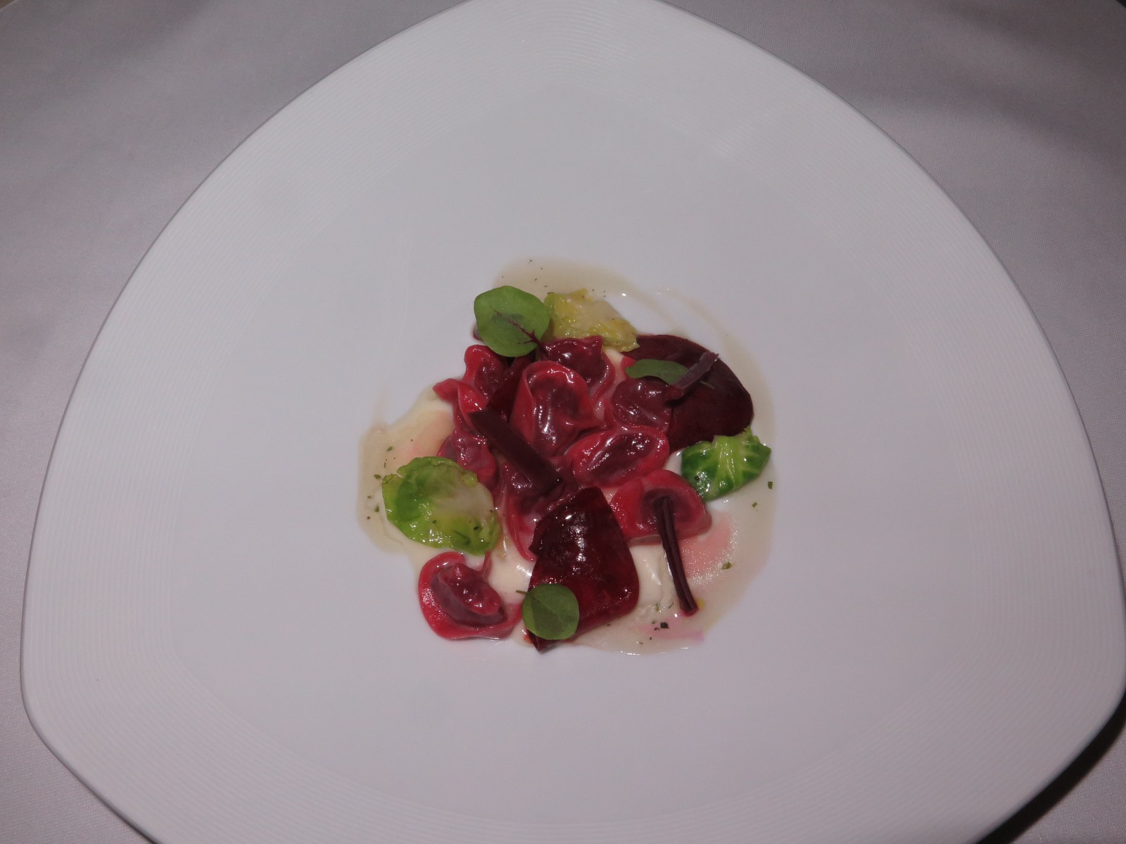 """Beetroot and red cabbage tortellini with parmesan cream and katsuobushi infusion"""